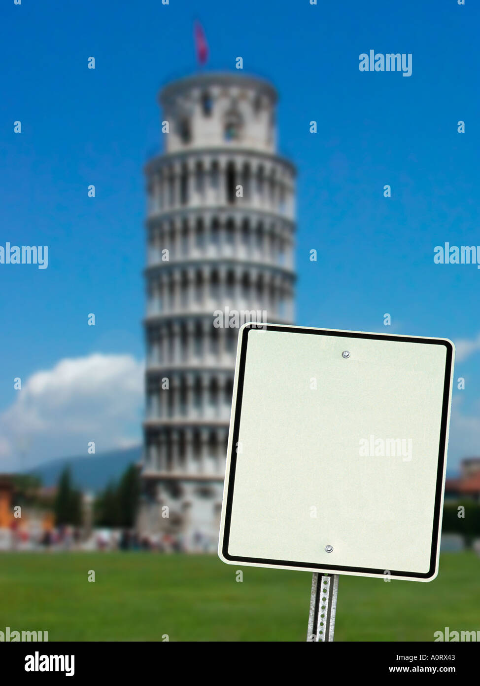 Blank sign leaning to one side with Leaning Tower of Pisa straight up in background one image in series of three - Stock Image