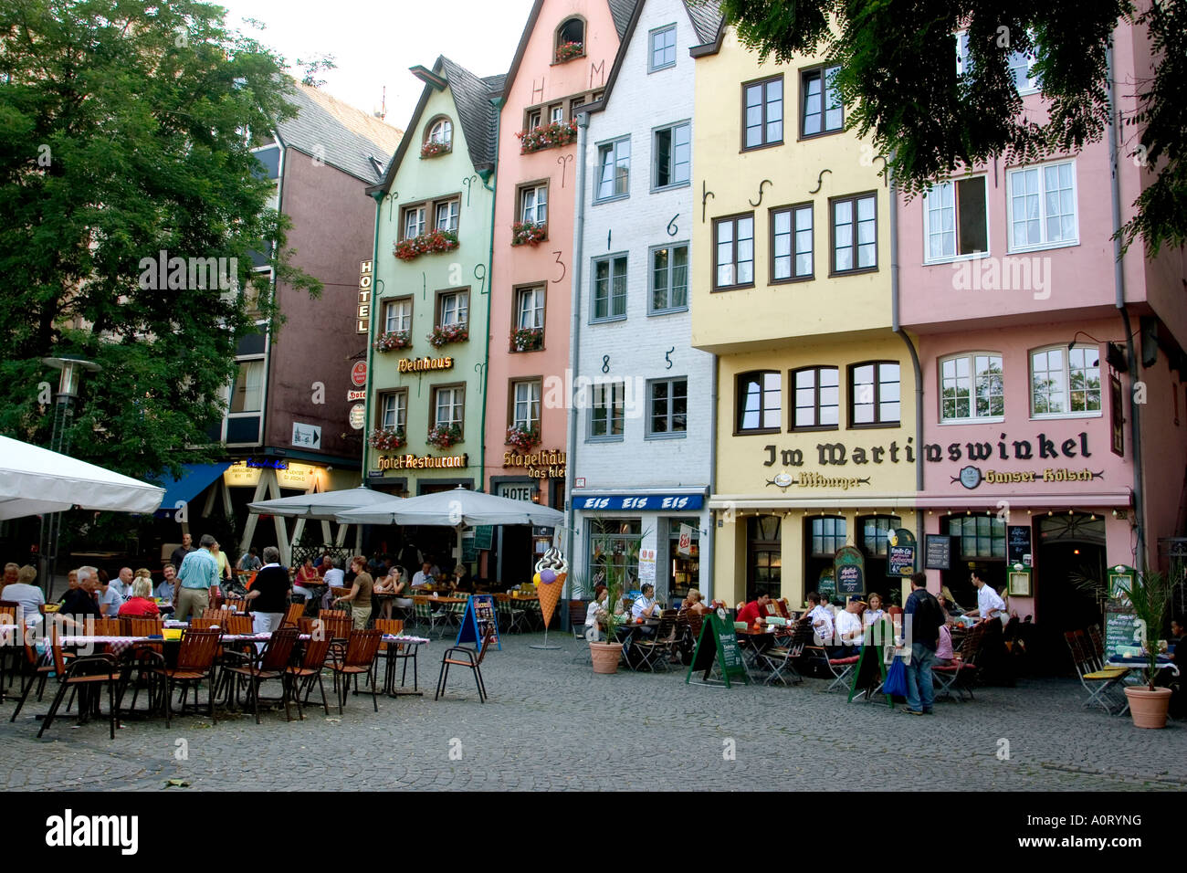 People sitting at outdoor restaurant in the old town near for Places that sell fish near me