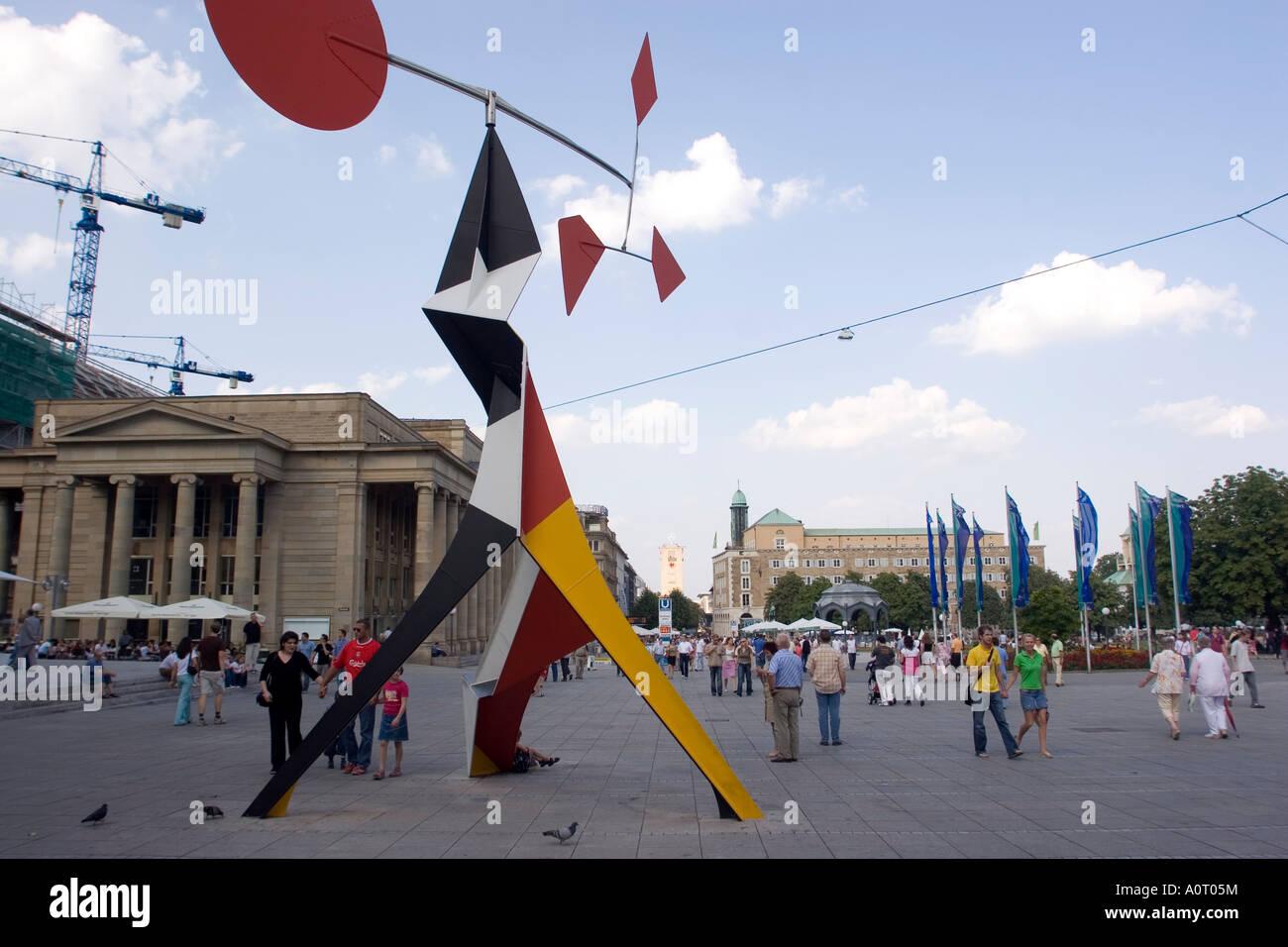 Alexander Calder s mobile statue and people on Konigstrasse King street pedestrianised main shopping street Stuttgart - Stock Image