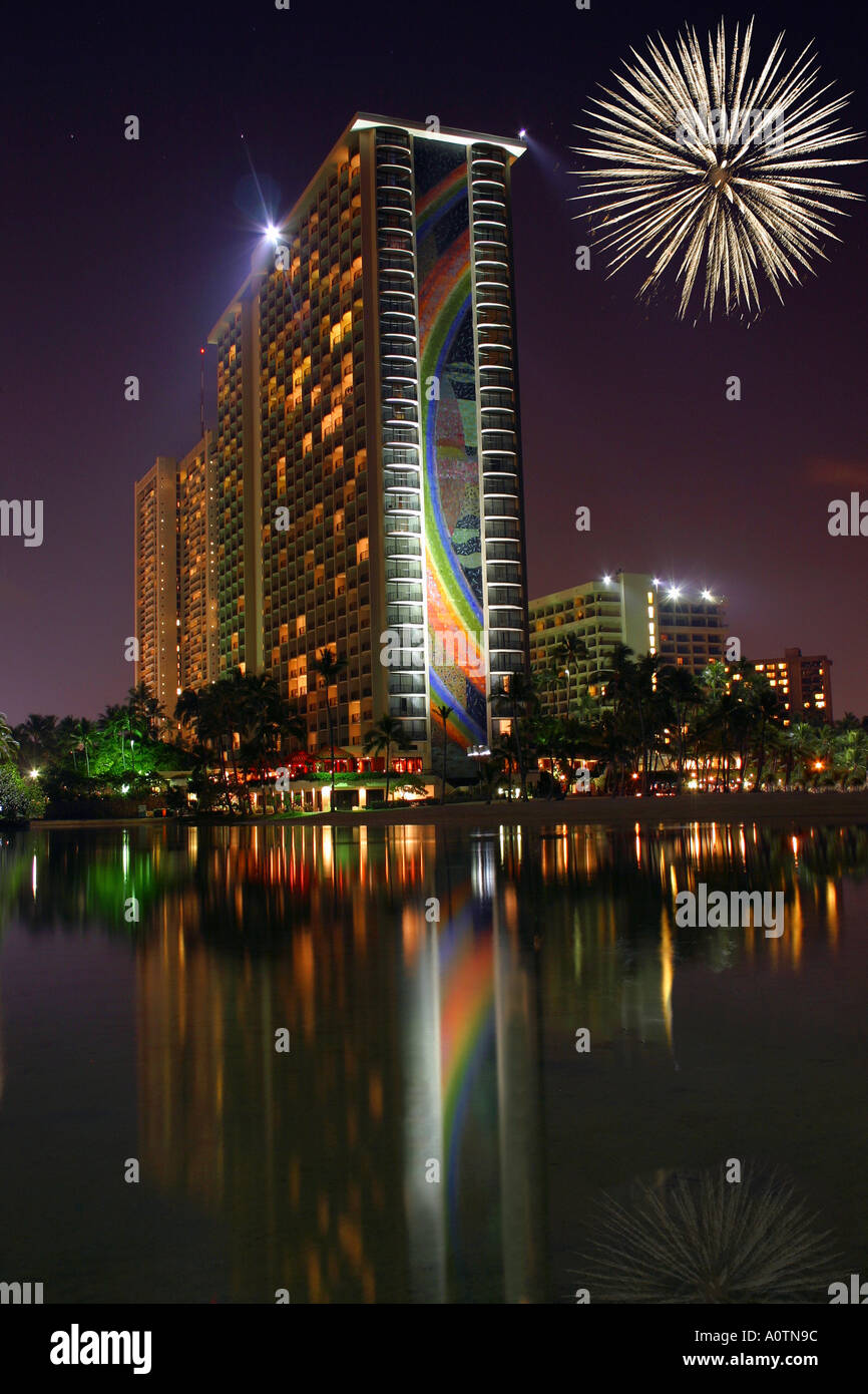 Hilton Hawaiian Village with fireworks and reflecting lagoon - Stock Image