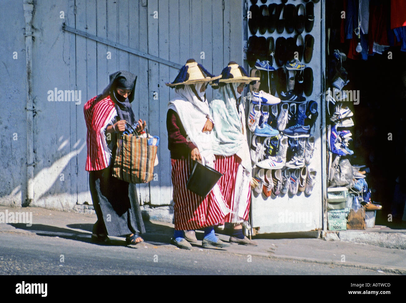 AFRICA MOROCCO TANGIER Berber women in traditional dress shopping in the kasbah section of old Tangier - Stock Image
