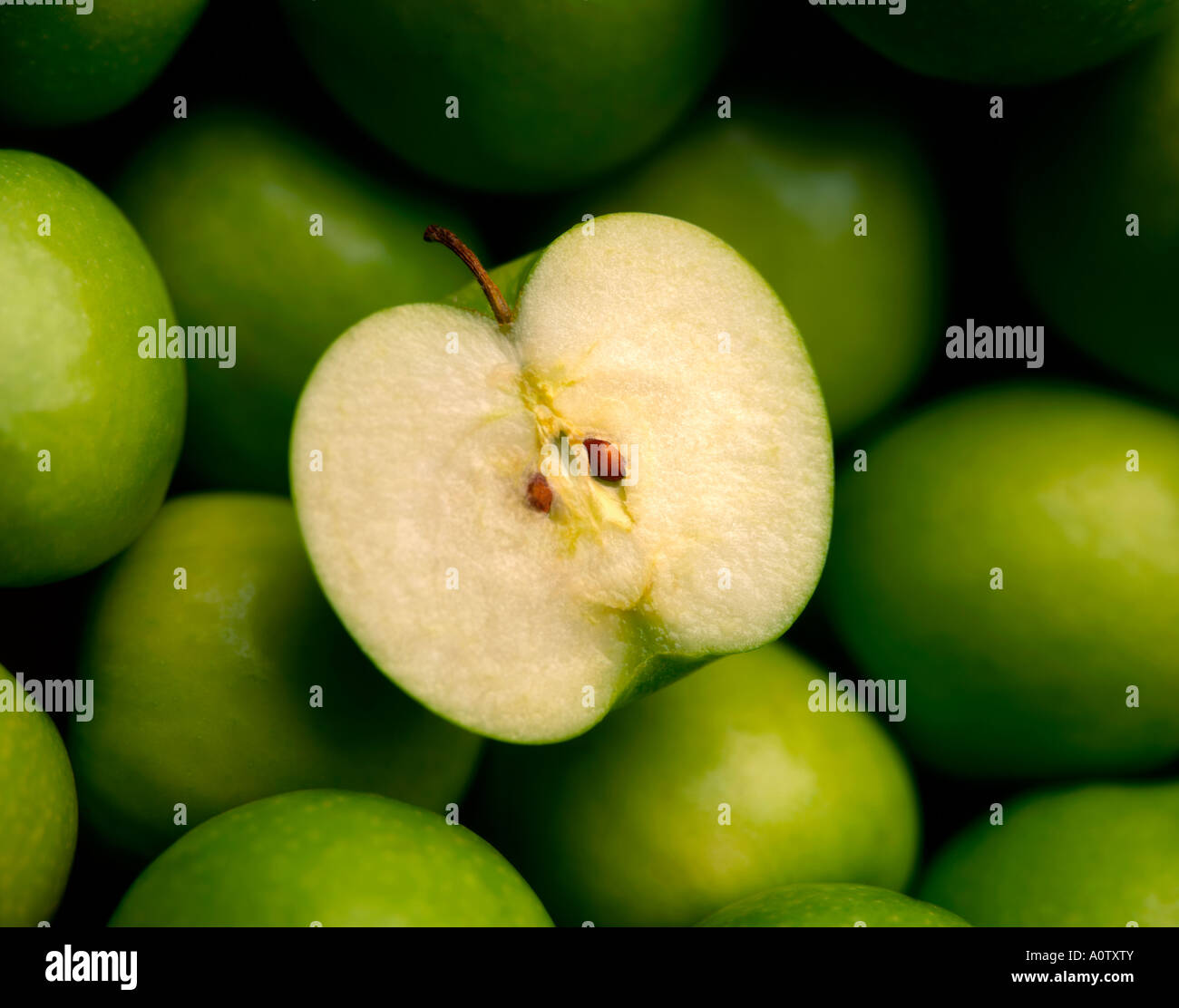 CUT GREEN APPLES - Stock Image