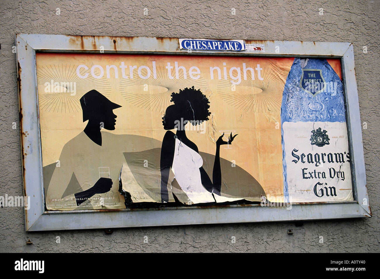Targeted advertising for alcohol in an African American neighborhood - Stock Image