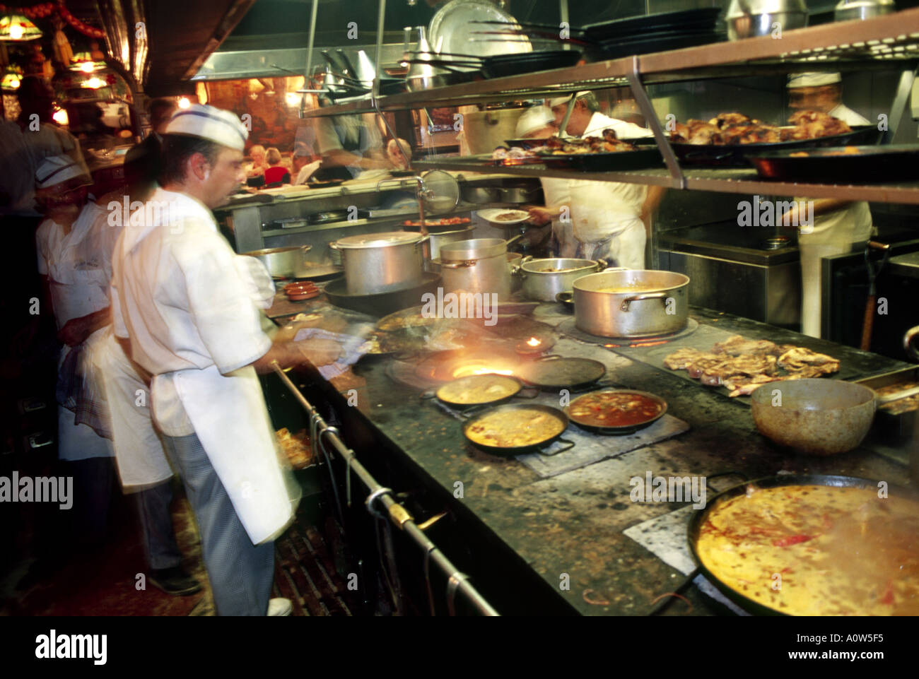 busy kitchen. Visitors To Los Caracoles Are Led Through The Busy Kitchen Area Their Tables C Luke Peters
