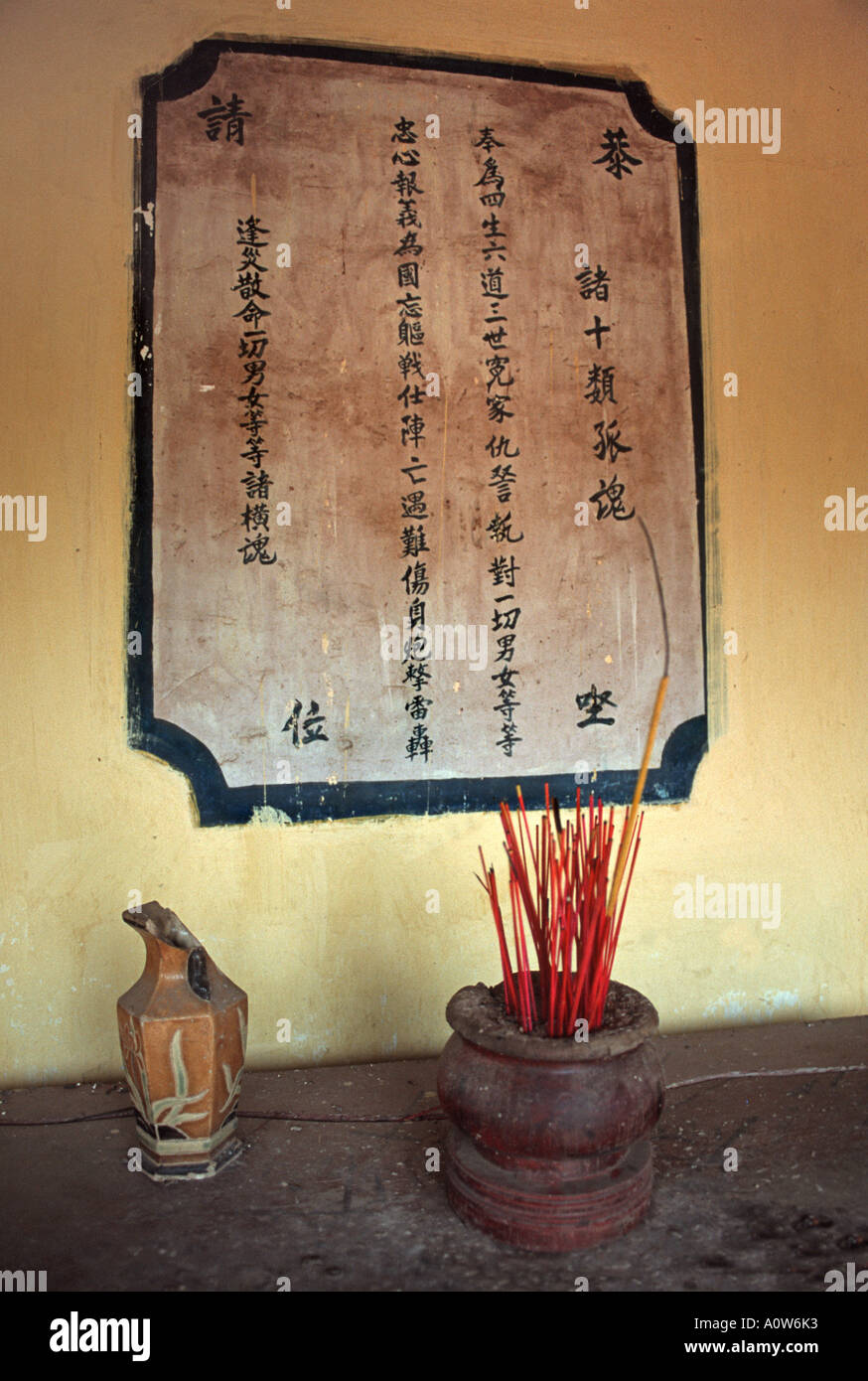 Incense sticks in a buddhist temple Saigon Ho Chi Minh city Vietnam - Stock Image
