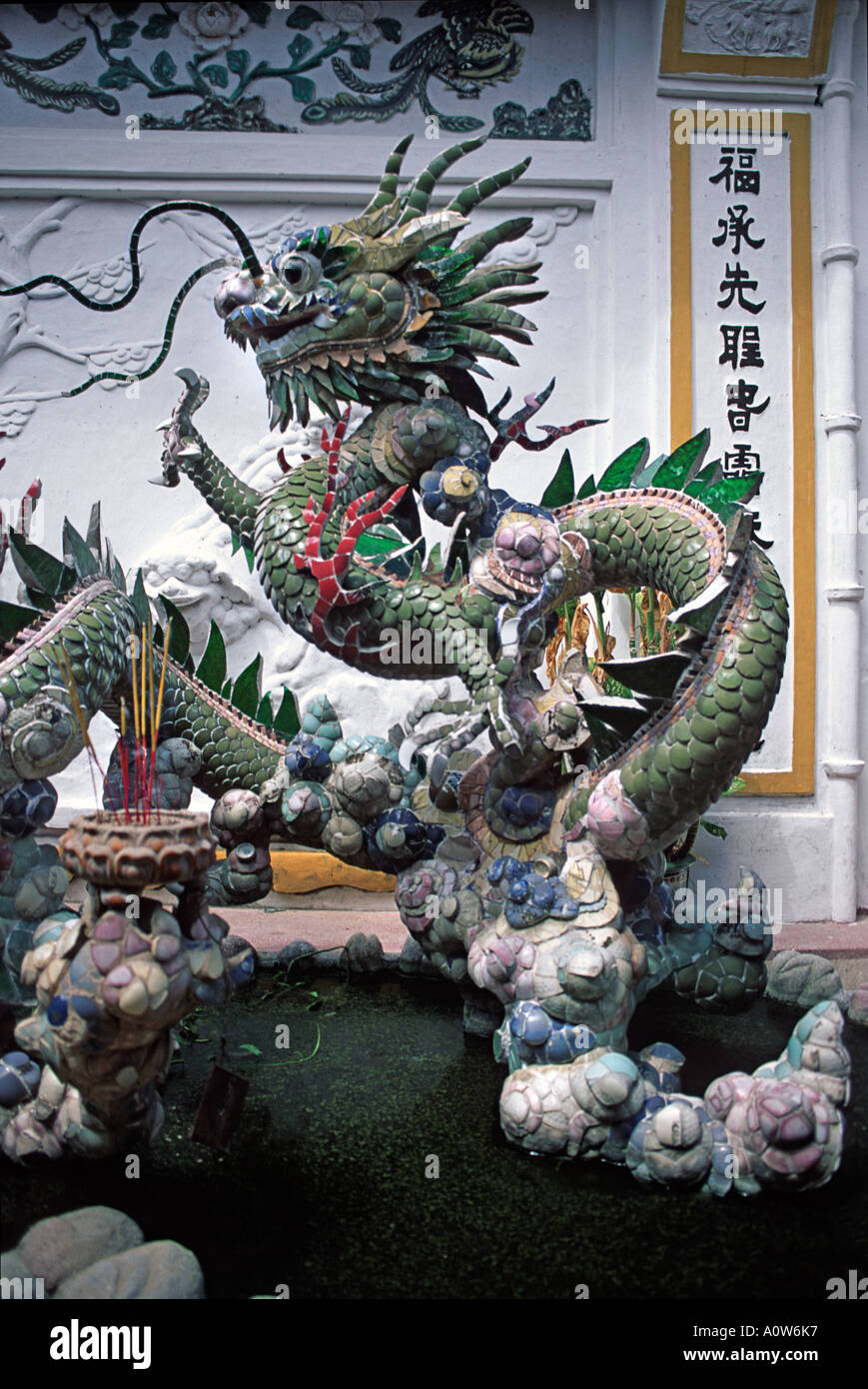 Ornate serpent dragon sculture at the Cantonese Assembly Hall Hoi An Vietnam - Stock Image
