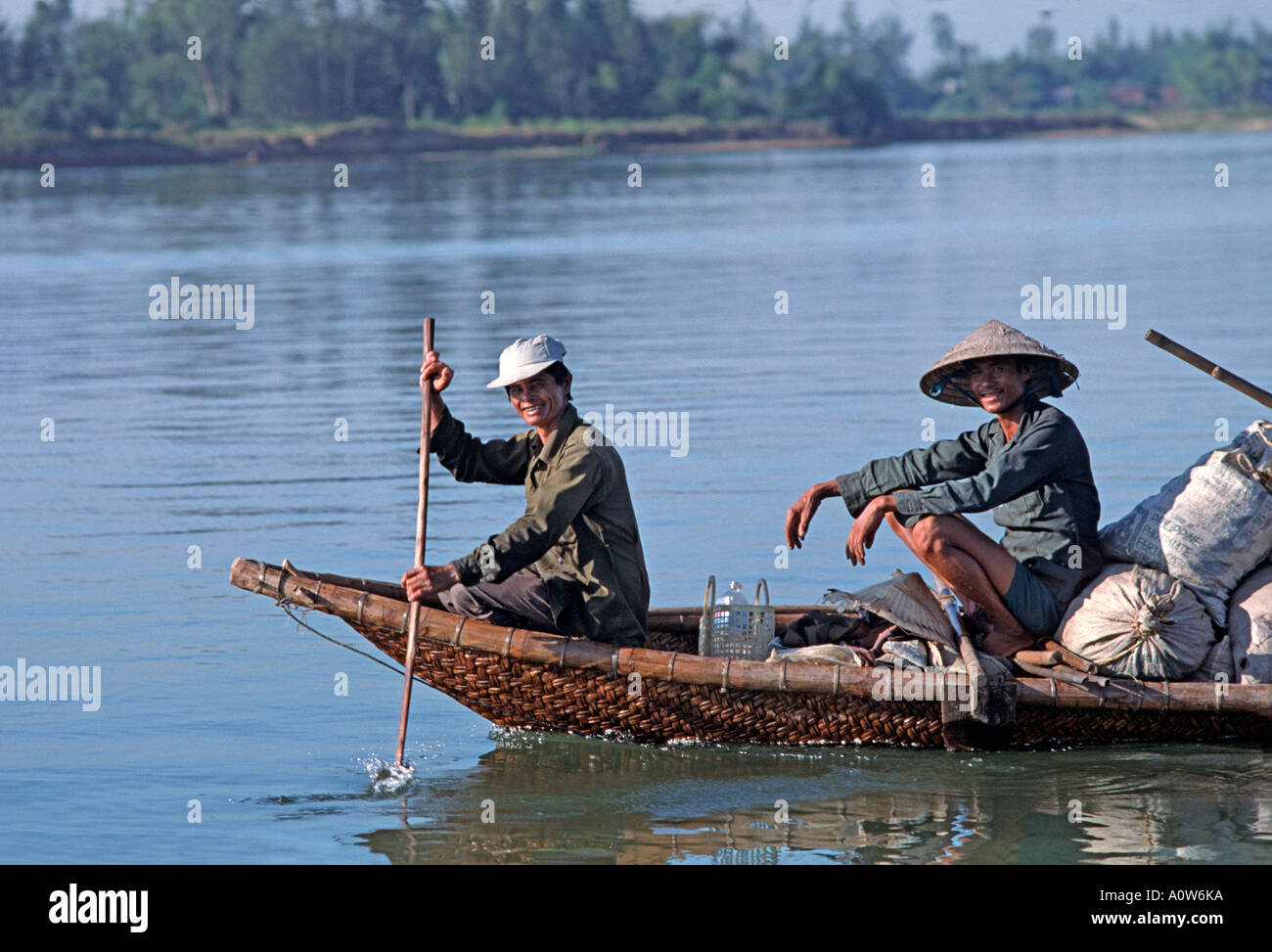 Friendly smiles Transporting goods to market by boat on the Thu Bon River Hoi An Vietnam - Stock Image