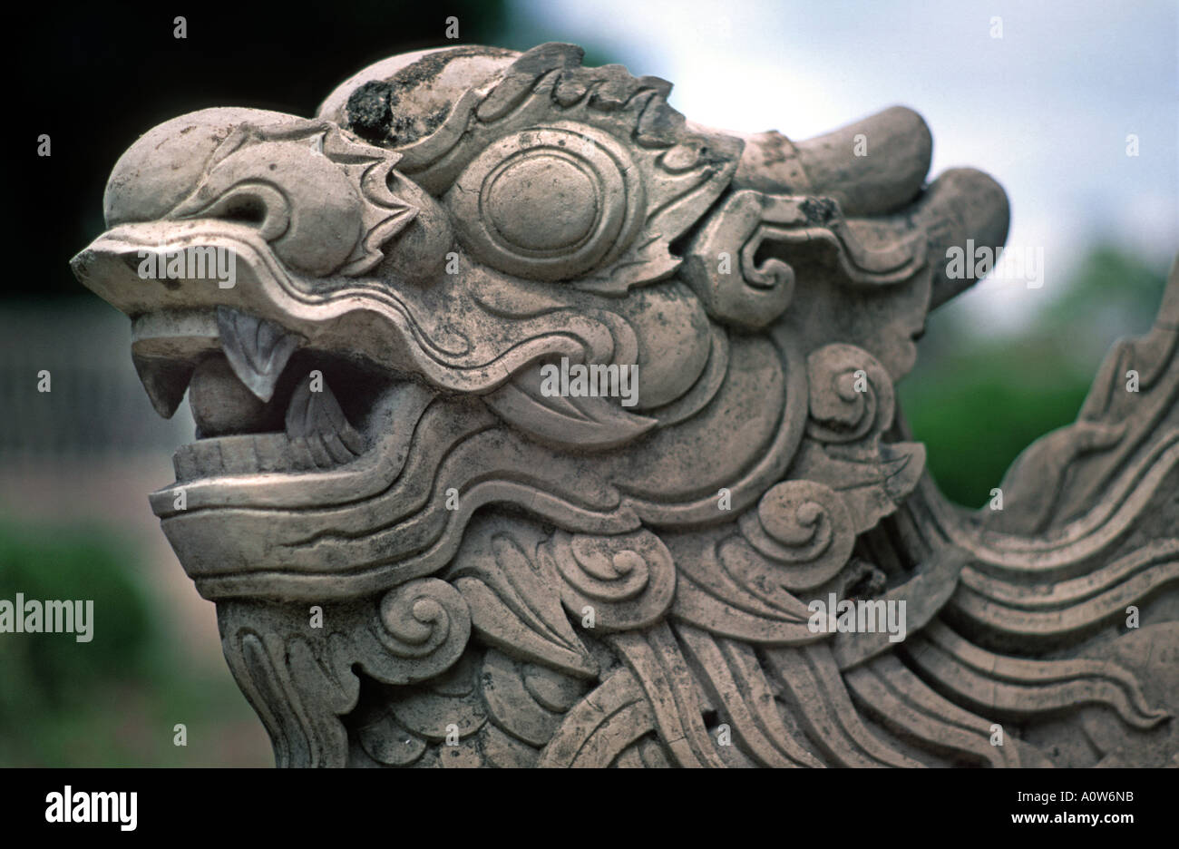 A guardian dragon Temple carving of Singha a Naga Hue Imperial Palace Vietnam - Stock Image