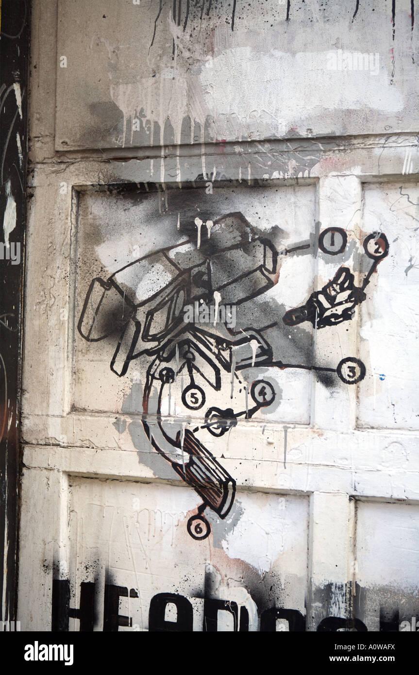 Robot schematics detail, from man in the mask killing office worker graffiti called 'Headache', Manhattan, - Stock Image