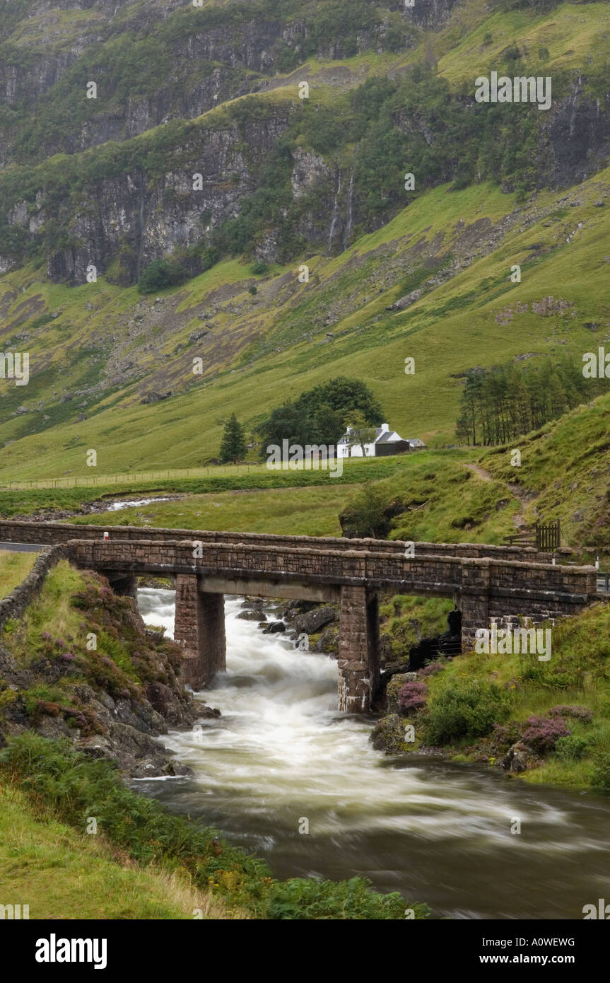Stone Bridge Crossing the River Coe with Croft in the Background Glen Coe Scotland Stock Photo