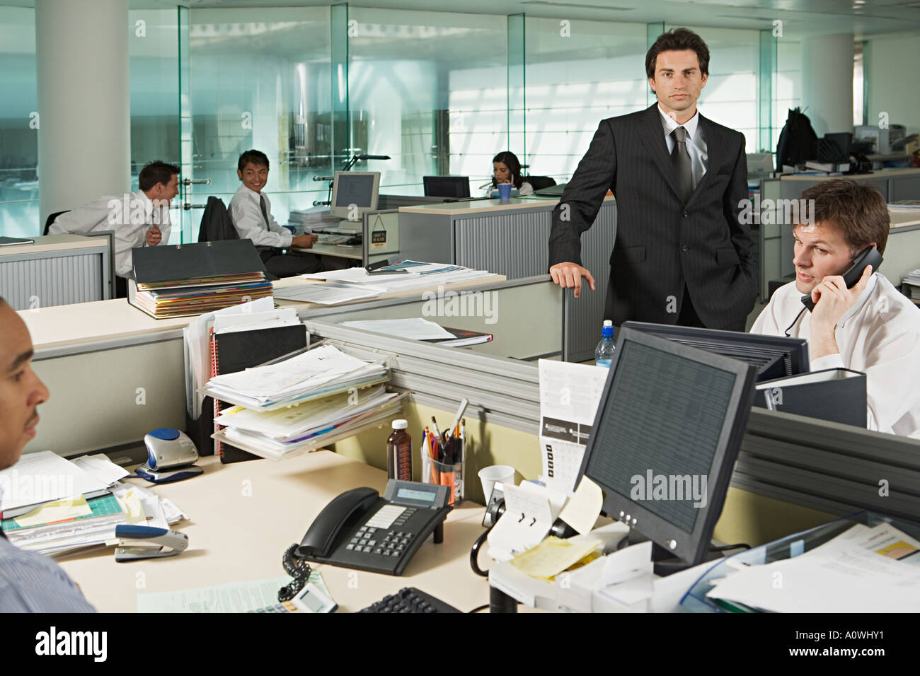 Businessman and office workers - Stock Image