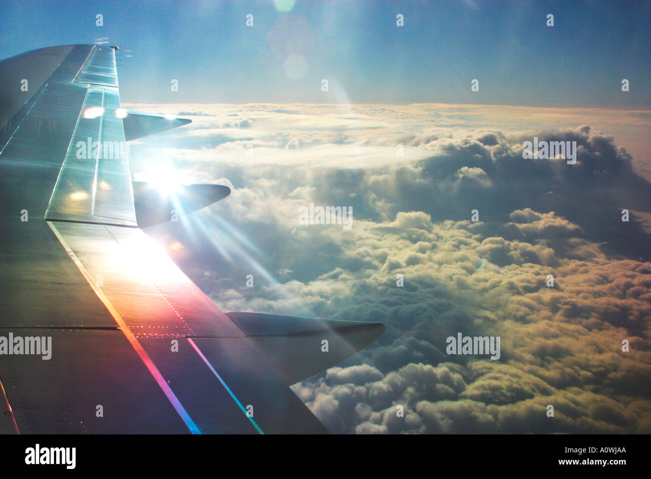 Jet Aircraft window view of sun and clouds over Europe from 30 000 feet - Stock Image
