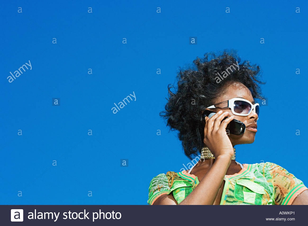 Young woman using a cellular telephone - Stock Image
