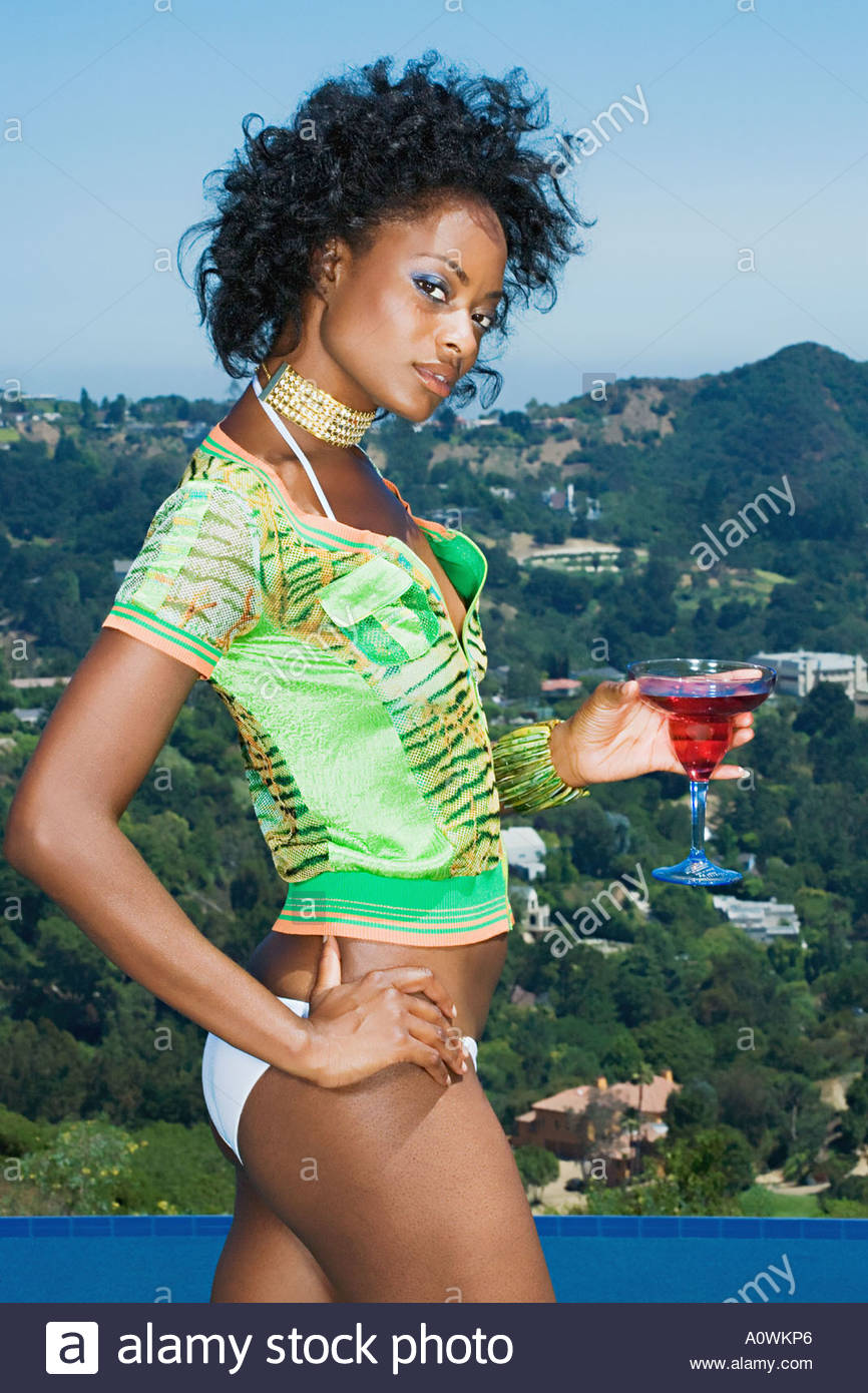 Young woman with a cocktail - Stock Image