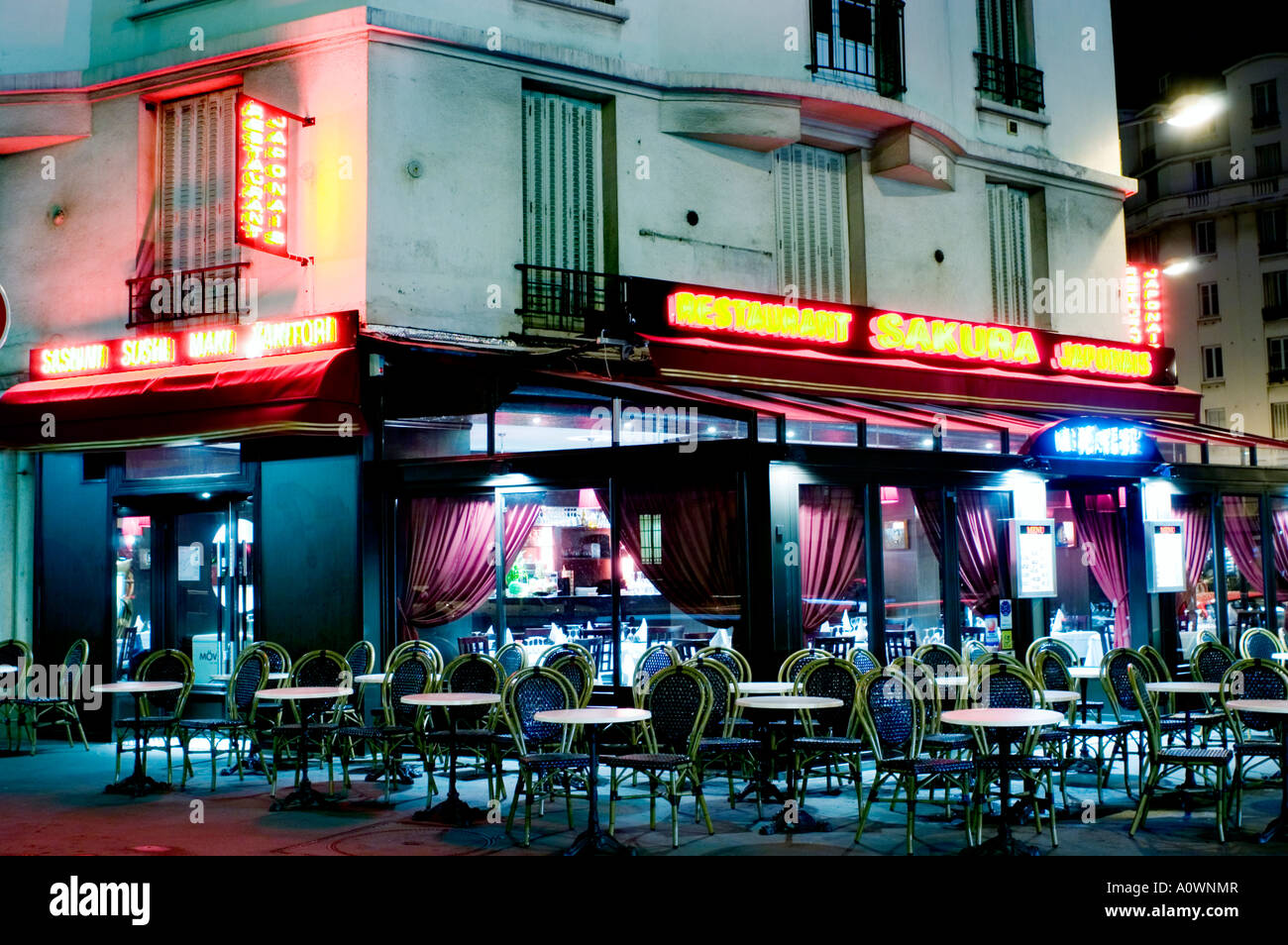 paris france japanese restaurant exterior lit up at night stock