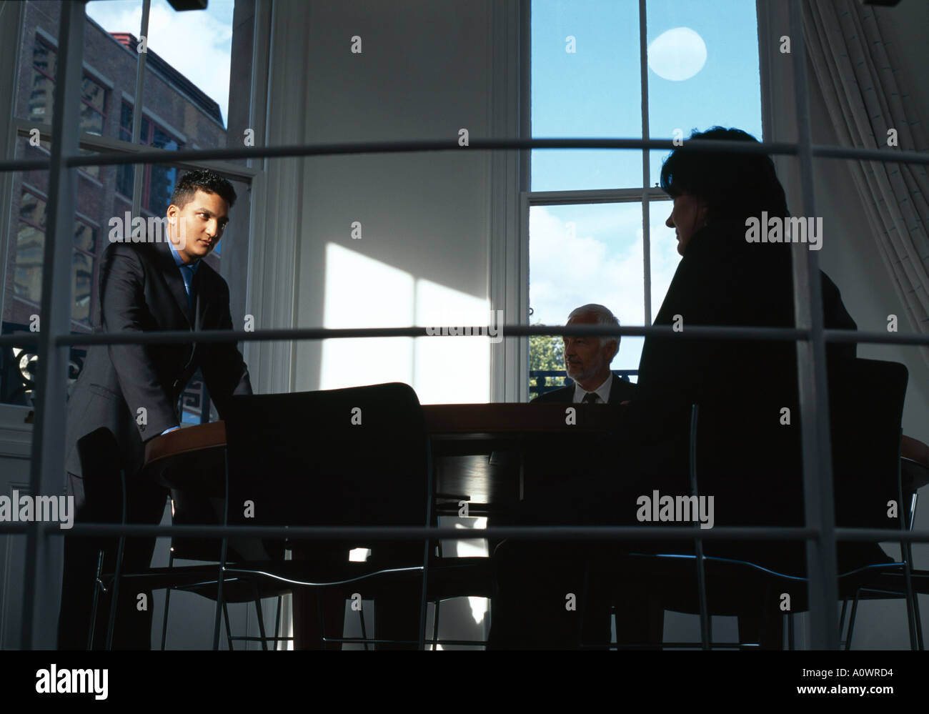 Office life and interiors. Business meeting with spotlit businessman. - Stock Image