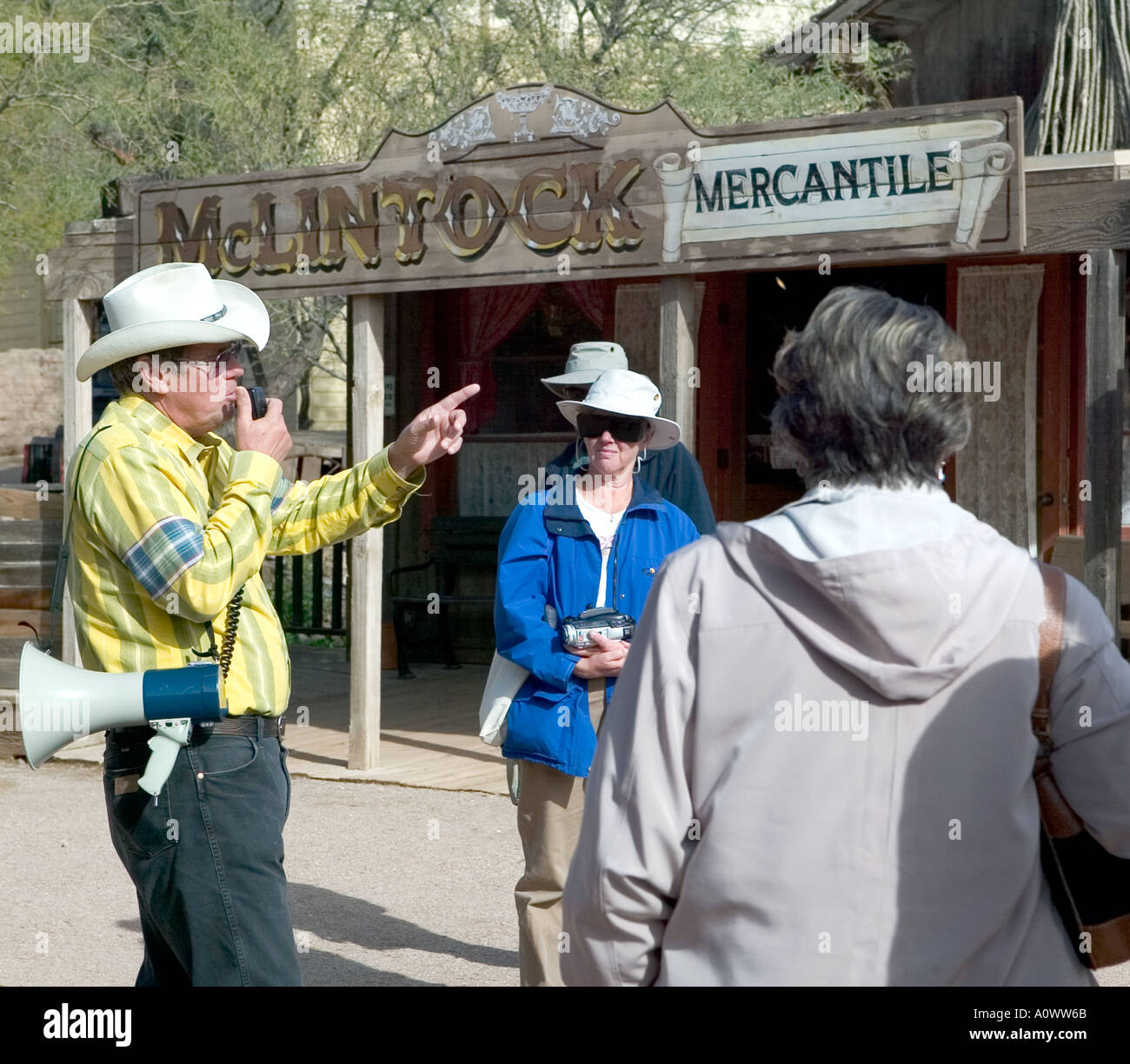 Tour group and guide with loud hailer at Tucson Studios Arizona USA - Stock Image
