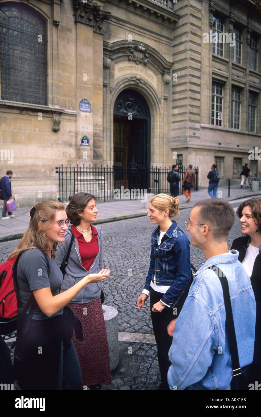 French college students outside the Sorbonne in Paris France  - Stock Image