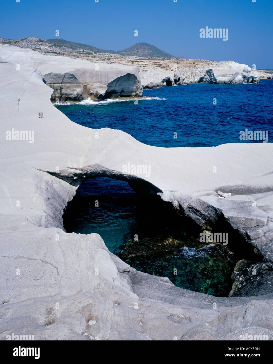 Volcanic rock formations on the coast Sarakiniko Milos Cyclades Islands Greek Islands Greece Europe - Stock Image
