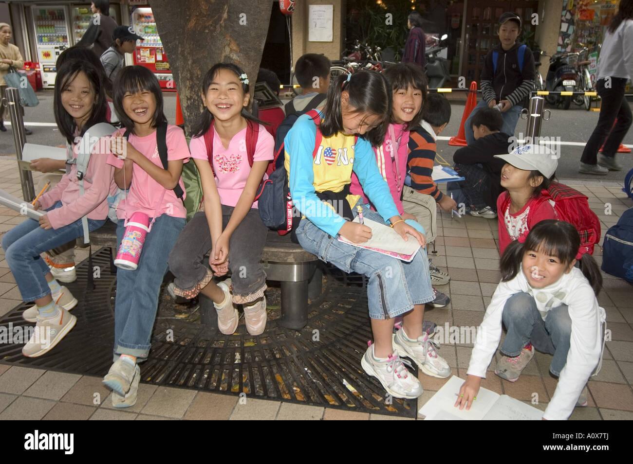 Children students on school trip Kyoto city Honshu Japan Asia - Stock Image