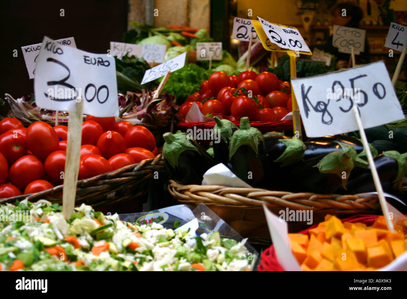 tomatoes salad eggplant aubergine and other  vegetables for sale in euros - Stock Image