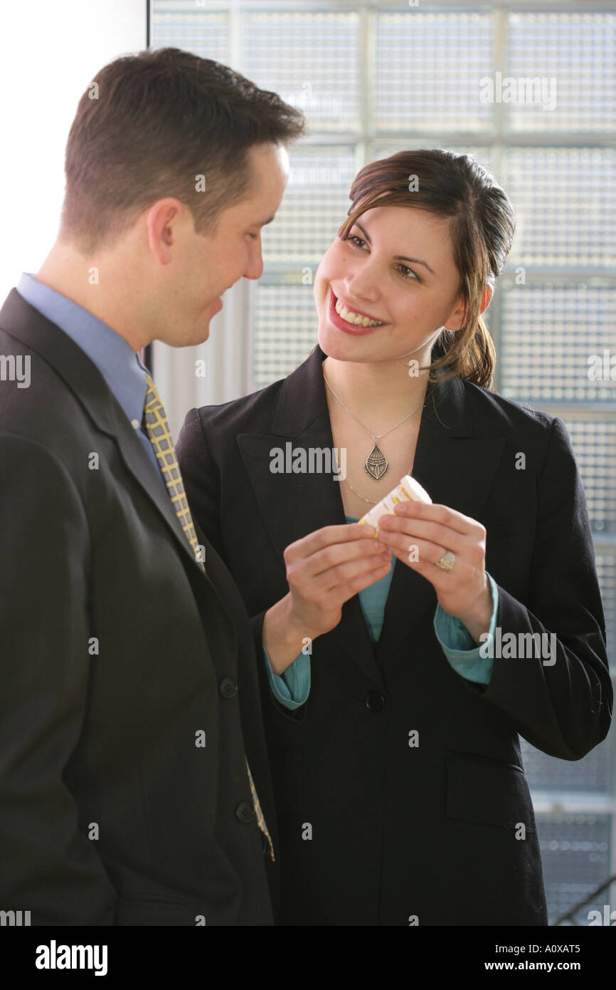 Medical Sales Or Pharmaceutical Rep (salesperson) Showing Drugs To Either  Another Sales Rep, Medical Administrator Or Doctor.