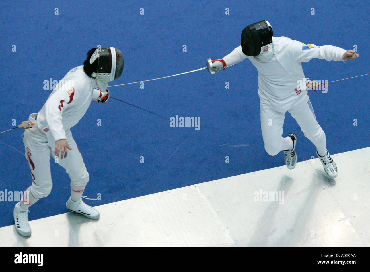 China L vs Ukraine epee bout during the Challenge  Monal in Paris 14 March 2004 - Stock Image