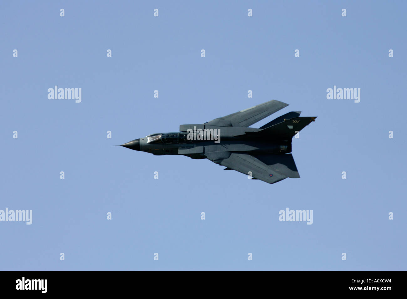 RAF Tornado GR4 flies with wings swept back in blue sky RIAT 2005 RAF Fairford Gloucestershire England UK - Stock Image