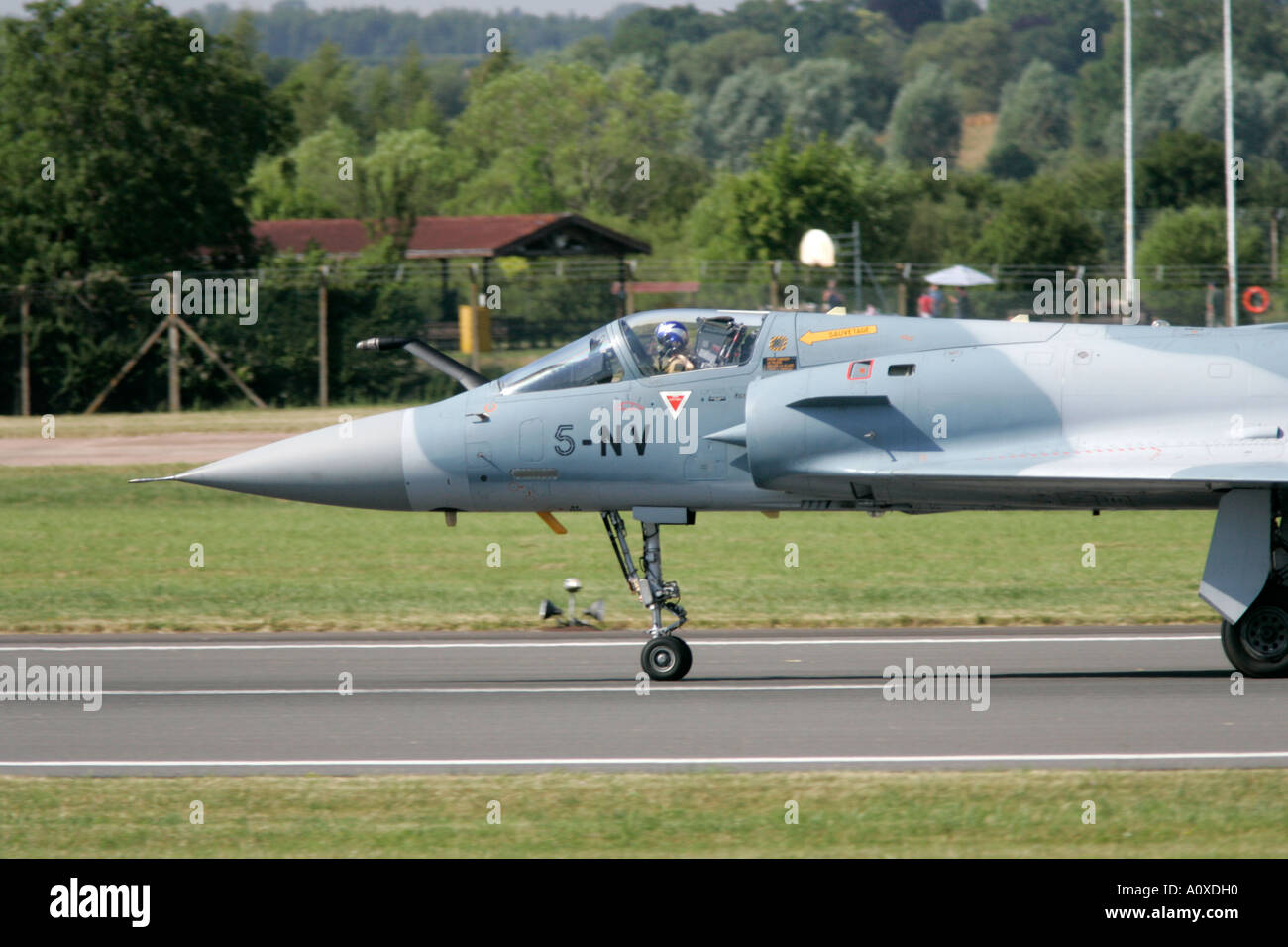 French AF Mirage 2000C lands on runway at RIAT 2005 RAF Fairford Gloucestershire England UK - Stock Image