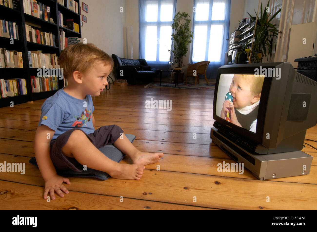 Child watching a video - Stock Image