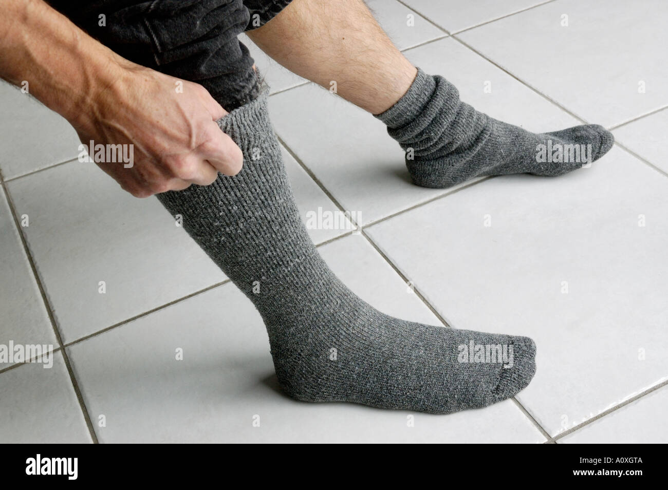 Pulling Up Socks Stock Photos & Pulling Up Socks Stock Images - Alamy