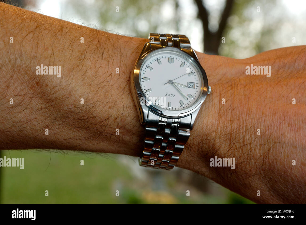 Wrist watch on arm of a man - Stock Image