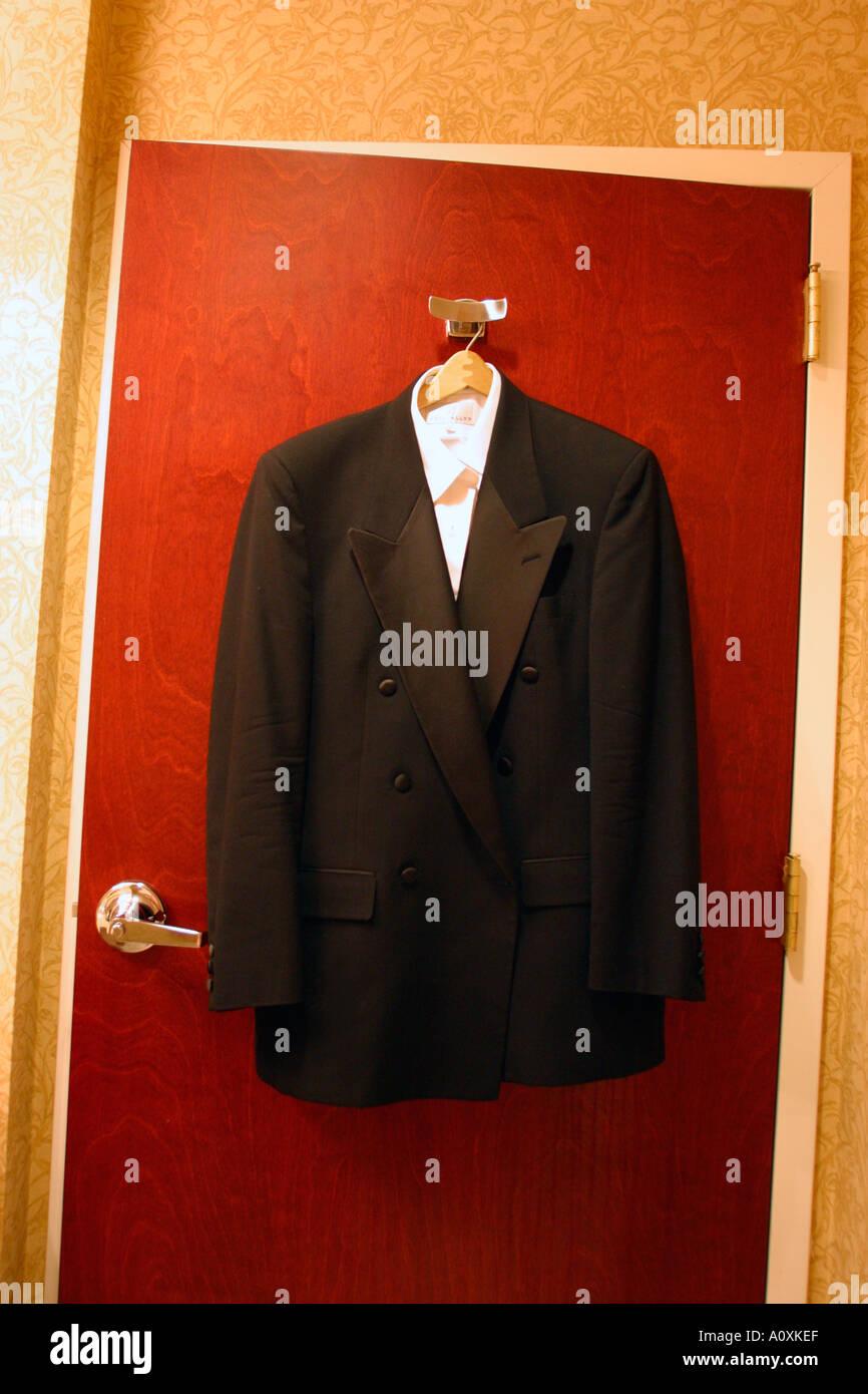 Tuxedo Hanging on Hotel Room Door - Stock Image