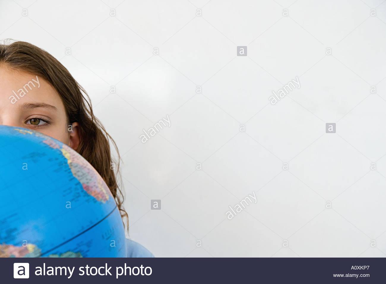Girl with globe - Stock Image