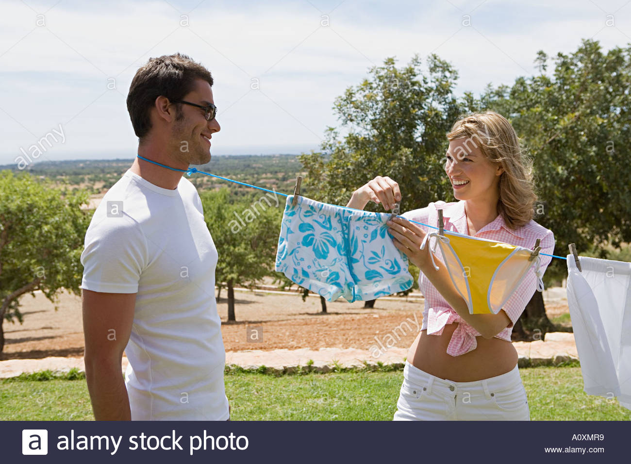 Man with clothes line tied round his neck - Stock Image