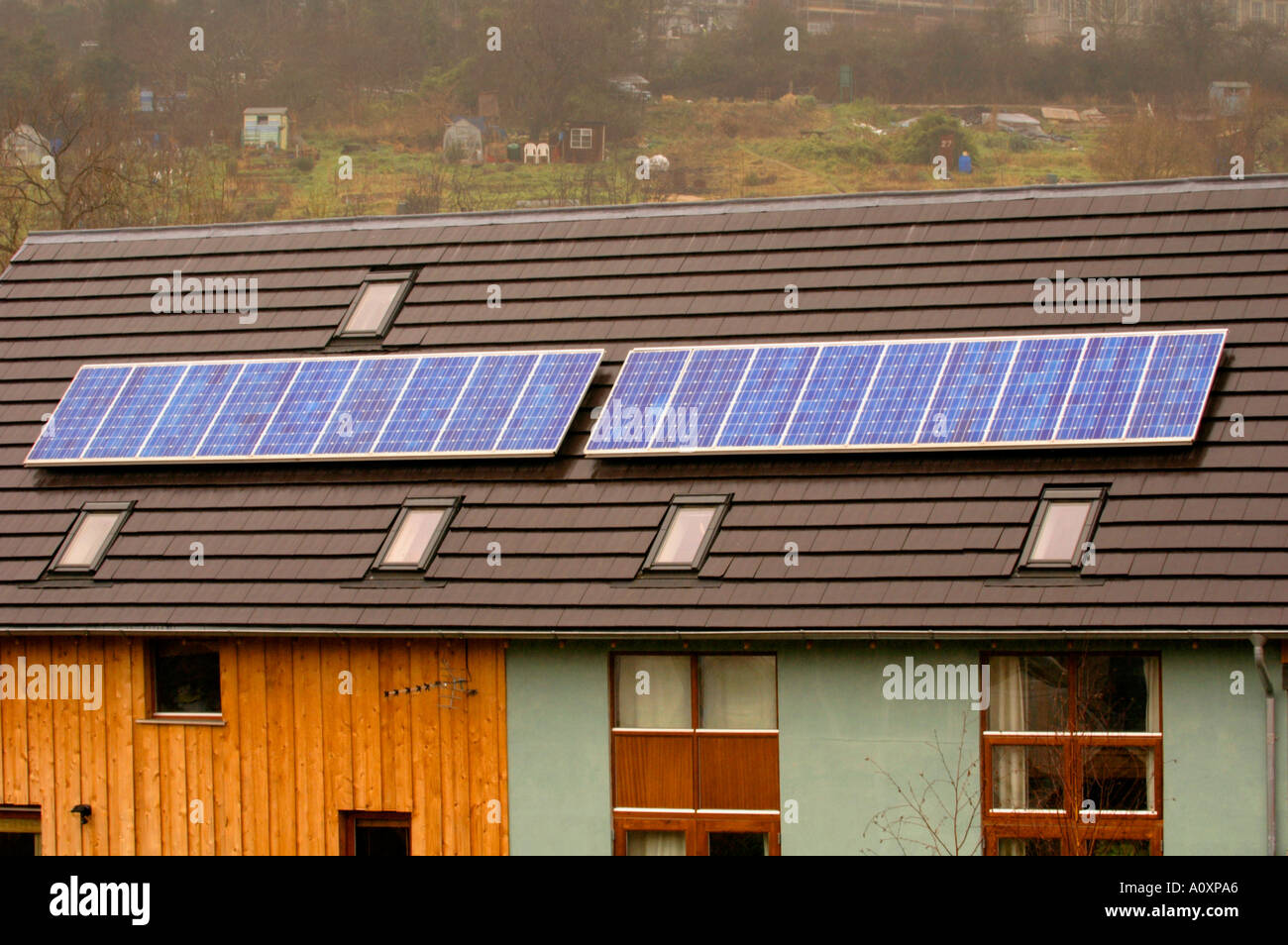 Self build ECO homes with solar panels on roof under construction at the Ashley Vale site in Bristol England UK - Stock Image