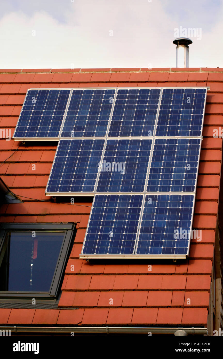 Self build ECO homes under construction at the Ashley Vale site in Bristol England UK GB solar panels on red tile roof - Stock Image