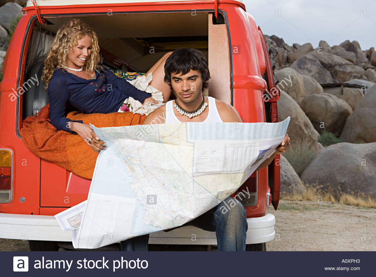 Couple in camper van reading a map - Stock Image