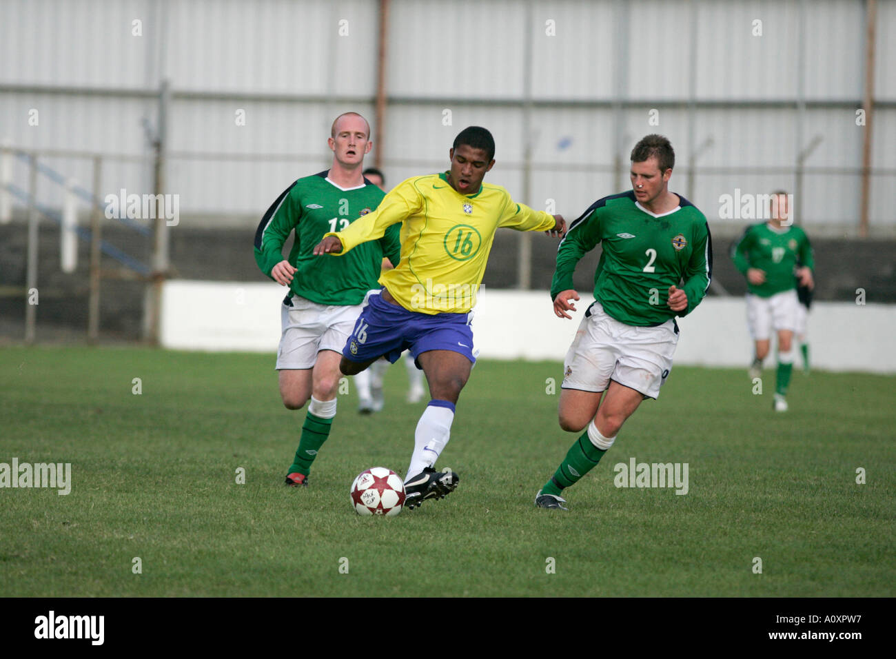 Brazil 16 Sammir sees off a challenge from N Ireland 2 Andrew Cleary Northern Ireland v Brazil elite section under 19 milk cup tournament - Stock Image