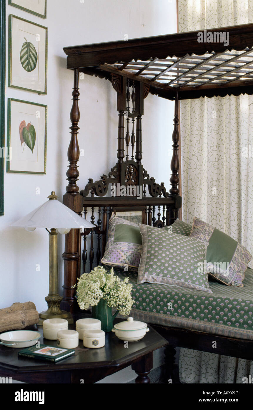 Colonial style four poster bed and antique enamel ware on bedside table in residential home Dehra Dun Himalayan - Stock Image