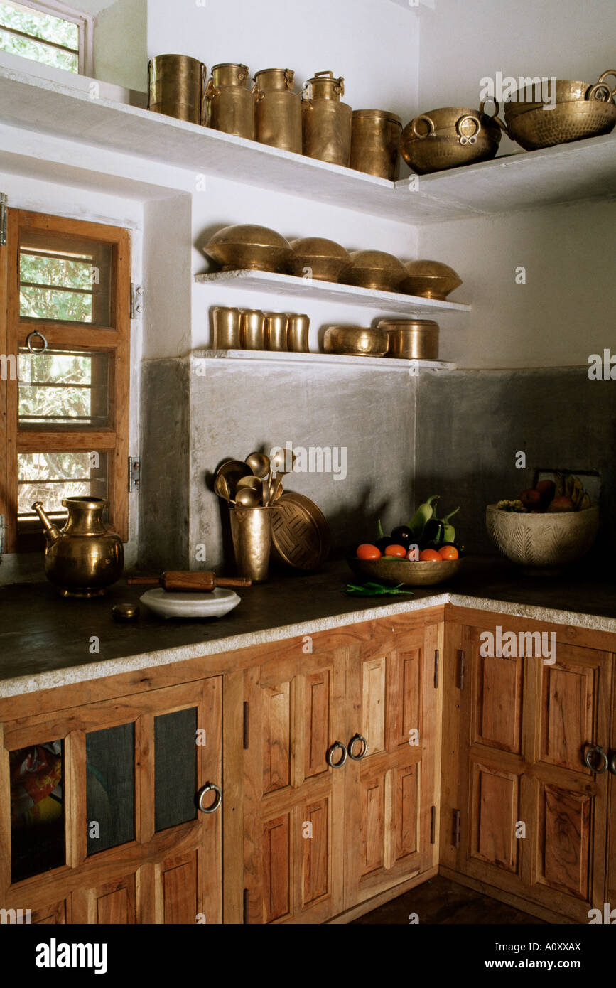 Traditional Brass Kitchen Utensils In Kitchen Area In