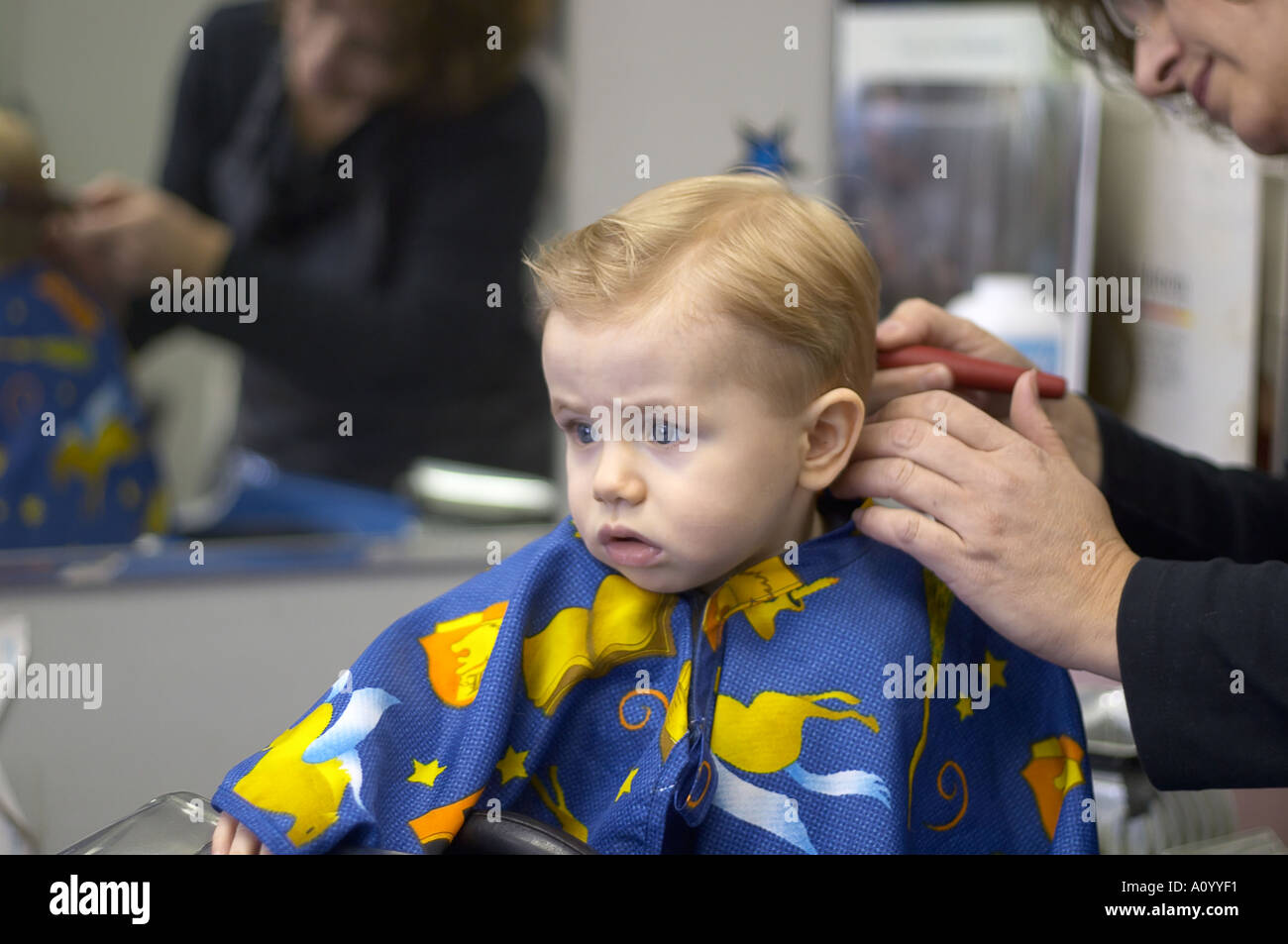 haircut for 1 year old boy one year boy sits in barber stool for haircut 4204 | one year old boy sits in barber stool for first haircut model released A0YYF1