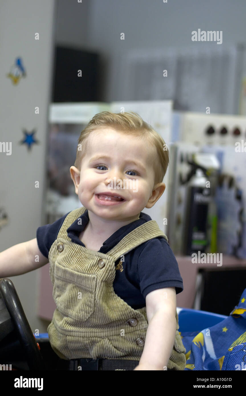 haircut for 1 year boy one year boy sits in barber stool for haircut 4204