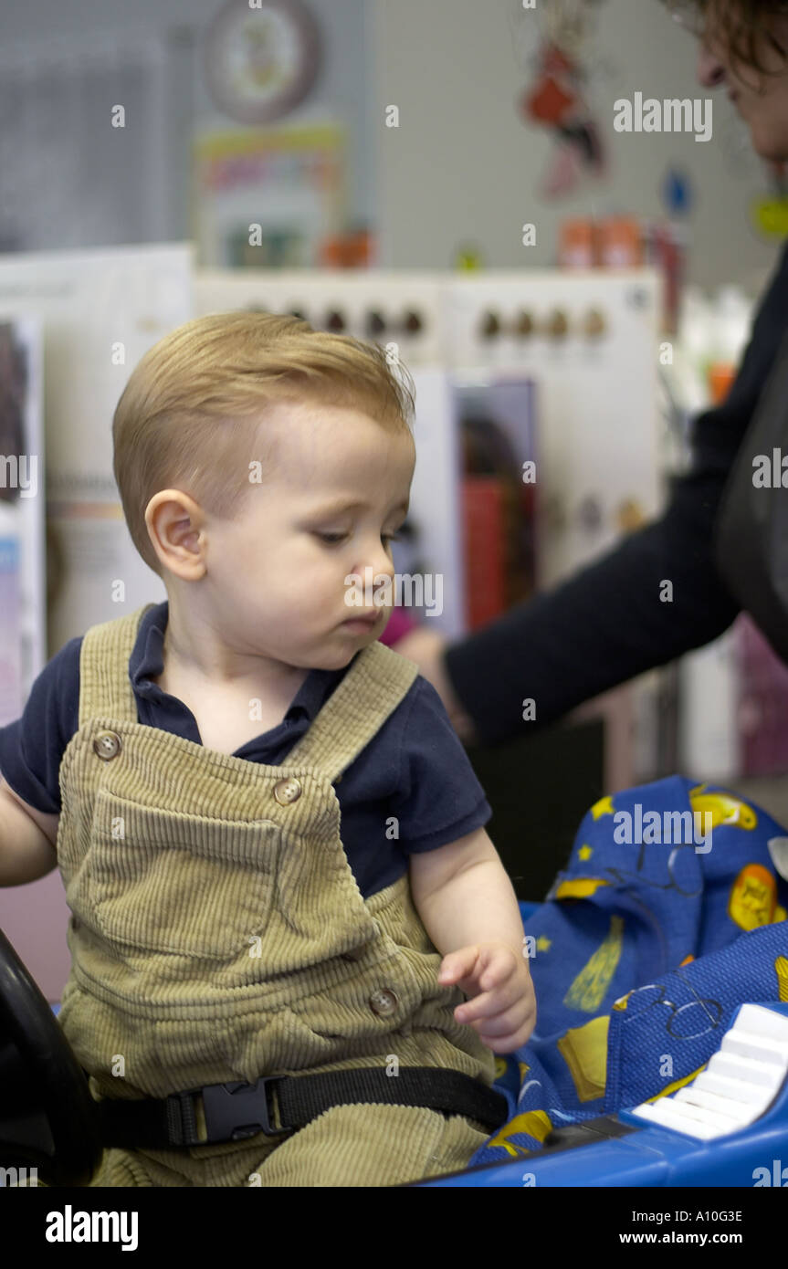 haircut for 1 year old boy one year boy sits in barber stool for haircut 4204 | one year old boy sits in barber stool for first haircut model released A10G3E