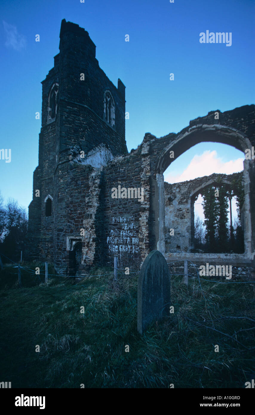 Ruins of hilltop church near Clophill East of Ampthill Bedfordshire Graffiti on walls desecrated graves - Stock Image