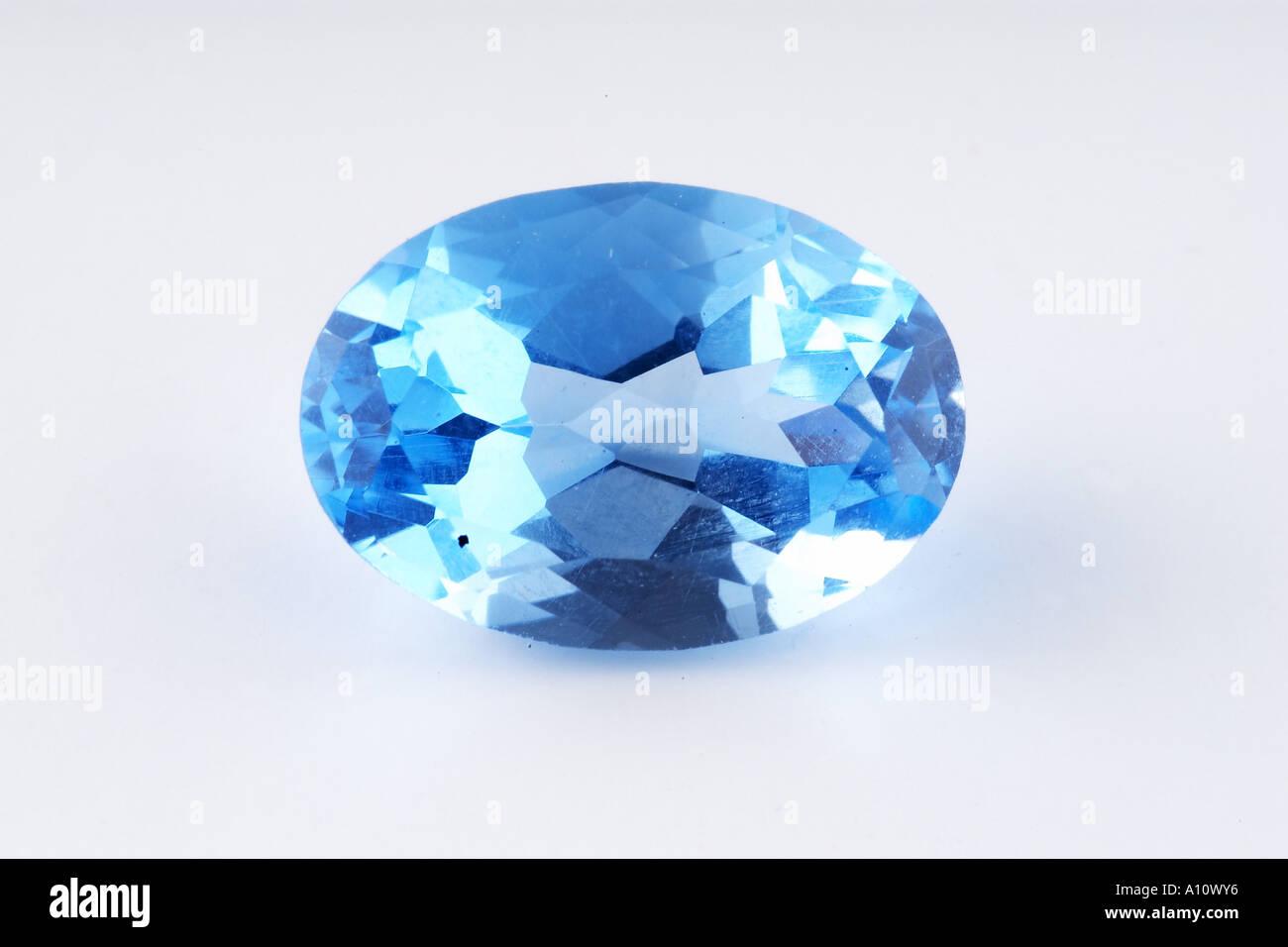 Blue Quartz one piece Semi Precious Stone expensive cut facet shining glitter on white background in studio tabletop stilllife - Stock Image