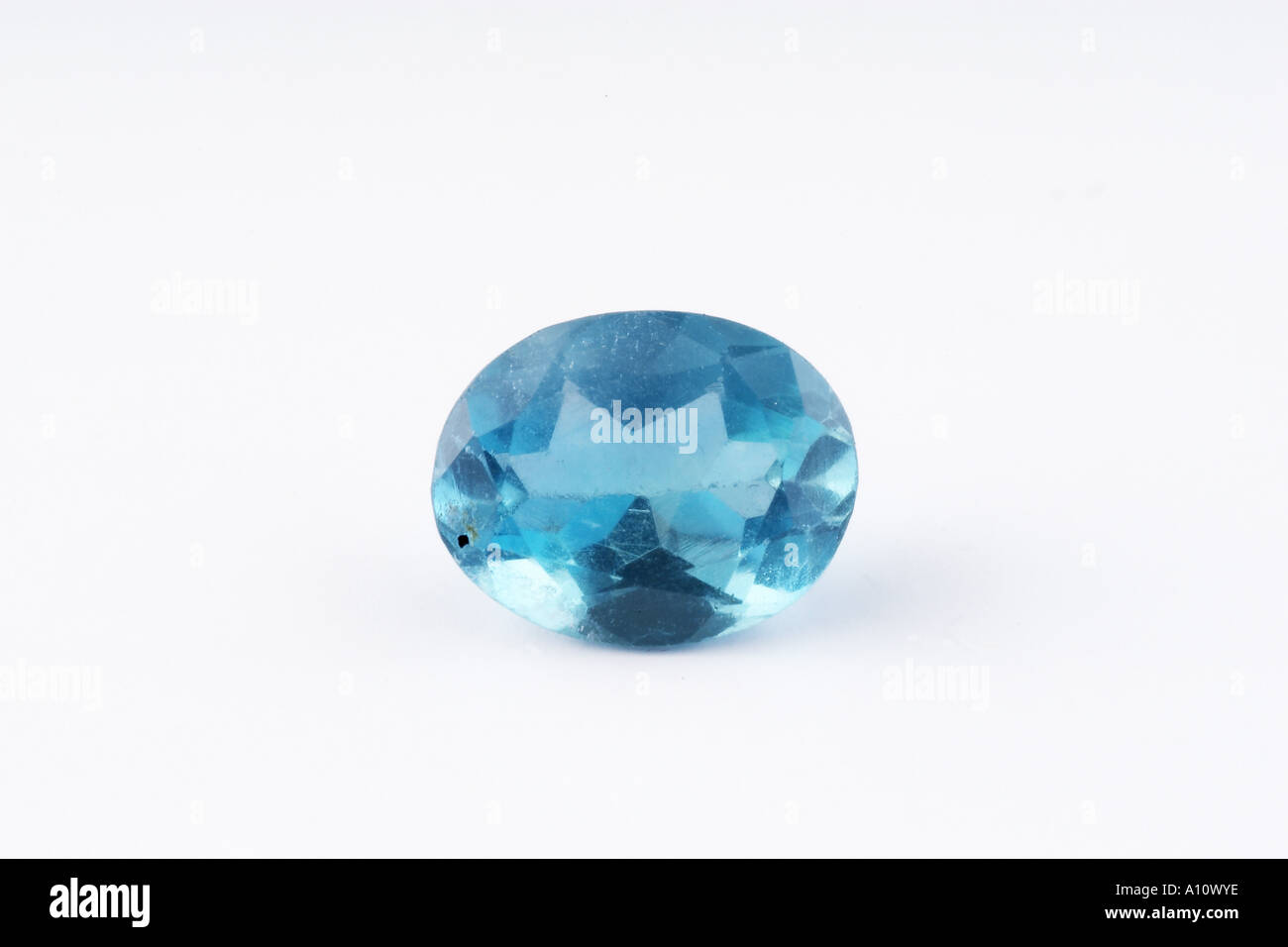 UGA75765 Blue Topaz Semi Precious Stone on white background in studio in India Asia - Stock Image