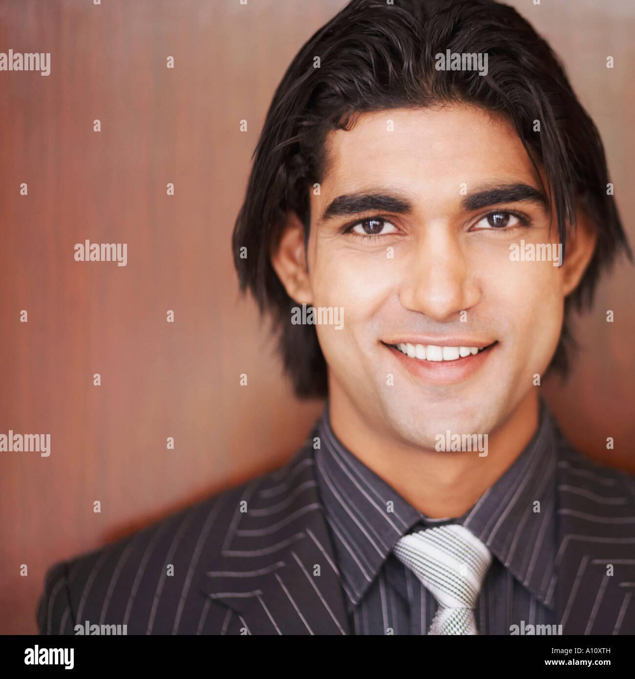 Portrait of a businessman smiling - Stock Image