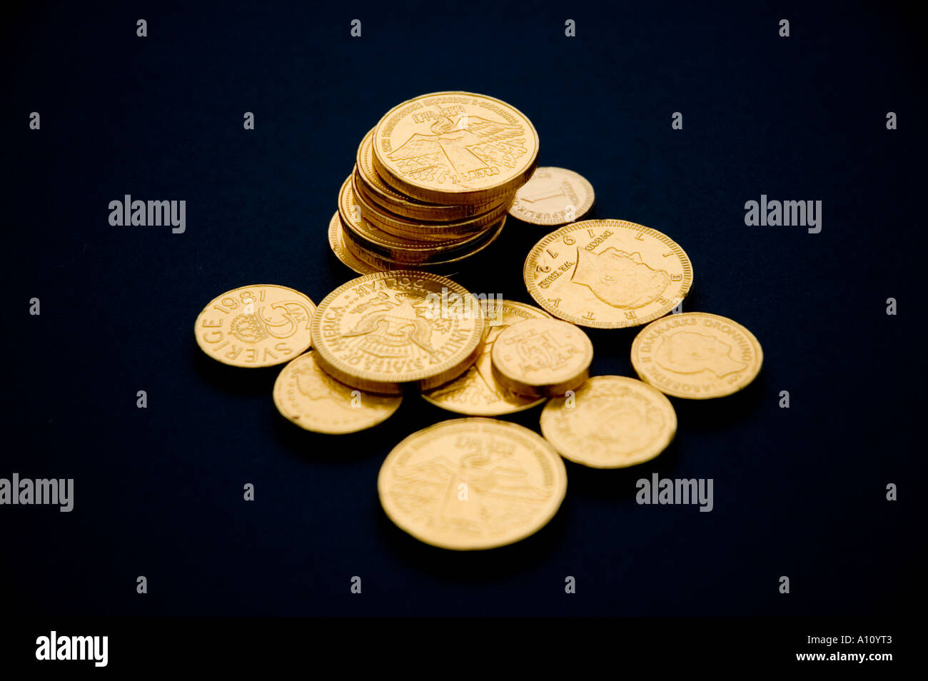 ed0a630e19e Artificial gold coins on a black background Stock Photo  5775554 - Alamy