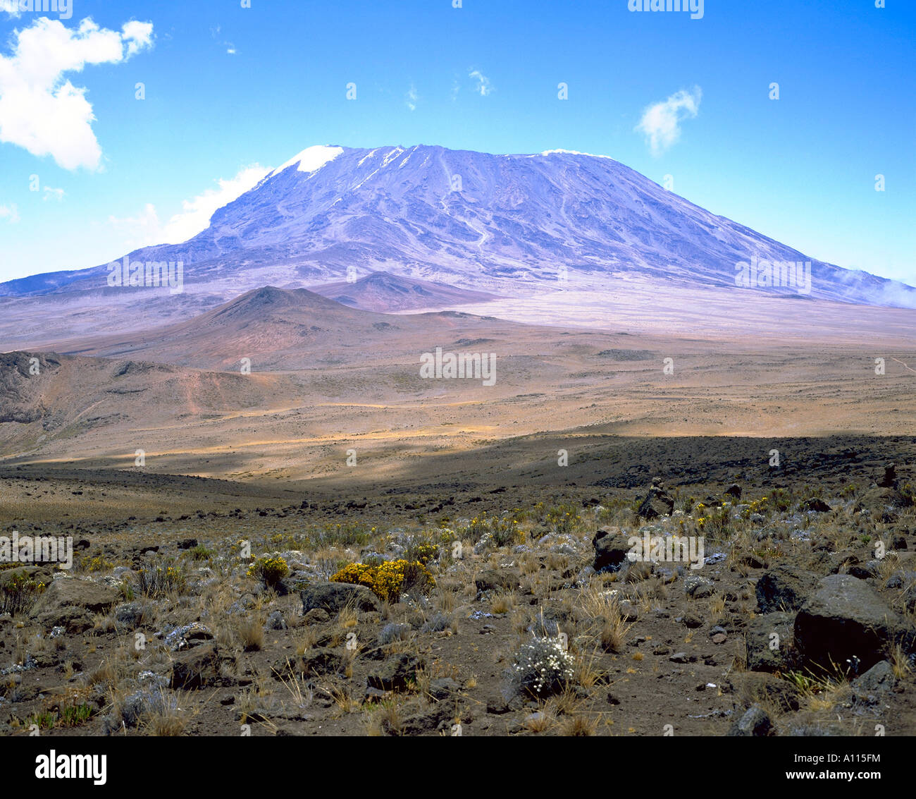 Looking to Kibo Peak Kilimanjaro across the barren expanse known as The Saddle - Stock Image